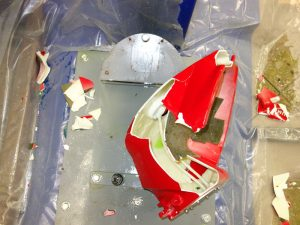 Aftermath of pendulum impact testing of a plastic gas tank.