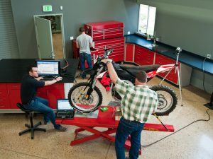 Off-road Motorcycle vehicle performance testing in our lab facility. We specialize in the testing and design of both road motorcycles and dirt bikes.