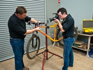 Photograph showing the detailed inspection and analysis of a bicycle involved in an accident.